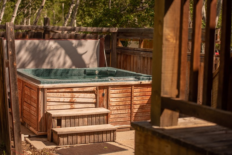 Enjoy the stars from your private hot tub steps from the bedroom