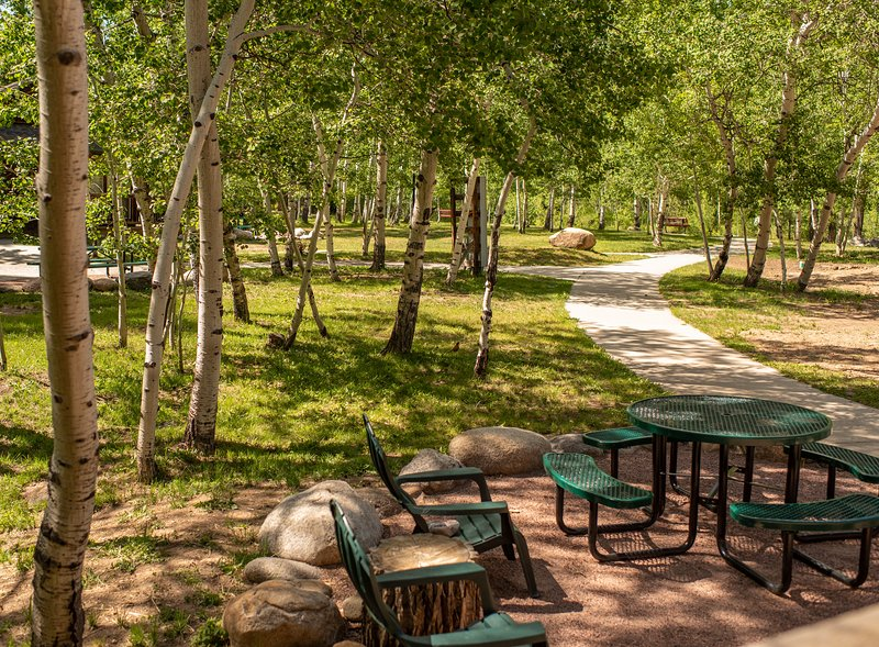 The porch is great to enjoy meals outside, hear the sound of the creek and aspen leaves jingling