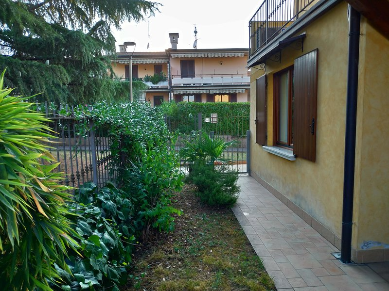 Small private garden suitable for children closed by entrance gate directly from the park