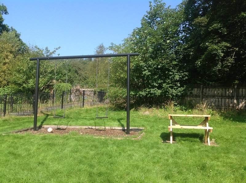 Outdoor swings ( for adults or children) and picnic bench.