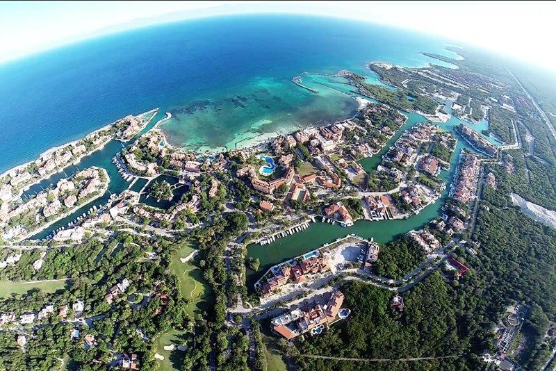 Bird's eye view of Puerto Aventuras town, marina and beaches