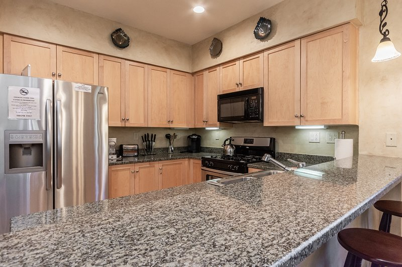 Kitchen with Granite counters, updated appliances and everything you need to cook a nice meal.