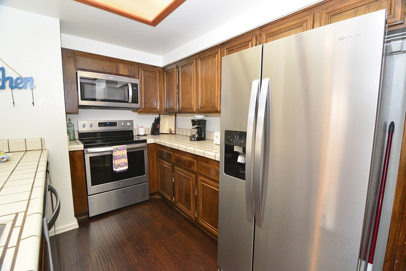 Kitchen with Brand New Stainless Appliances