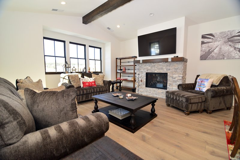 Living Area with Gas Fireplace, Smart TV, 2 couches and Chaise Lounge.