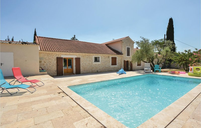 Amazing home in Calvisson with WiFi, Outdoor swimming pool and 1 Bedrooms (FLG52, holiday rental in Vergeze