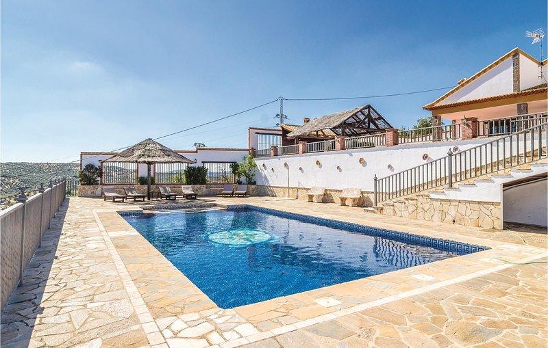 Nice home in Iznájar with Outdoor swimming pool, WiFi and 4 Bedrooms (EAC448), alquiler vacacional en Villanueva de Algaidas