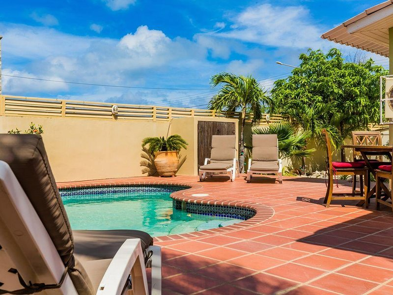 Private backyard, with lounge area, dining area, pool and patio