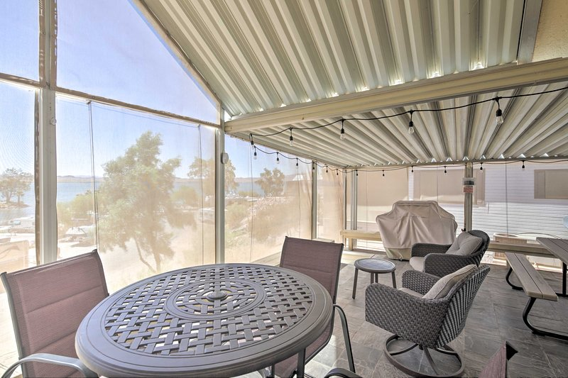 The home features a spacious covered deck with views of the lake and mountains