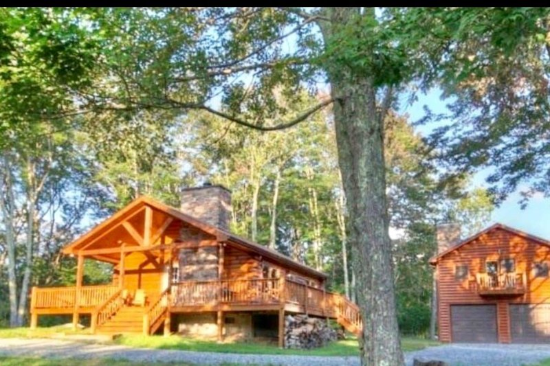 Two cabins for your group- a total of 3 bedrooms and 2 bathrooms.
