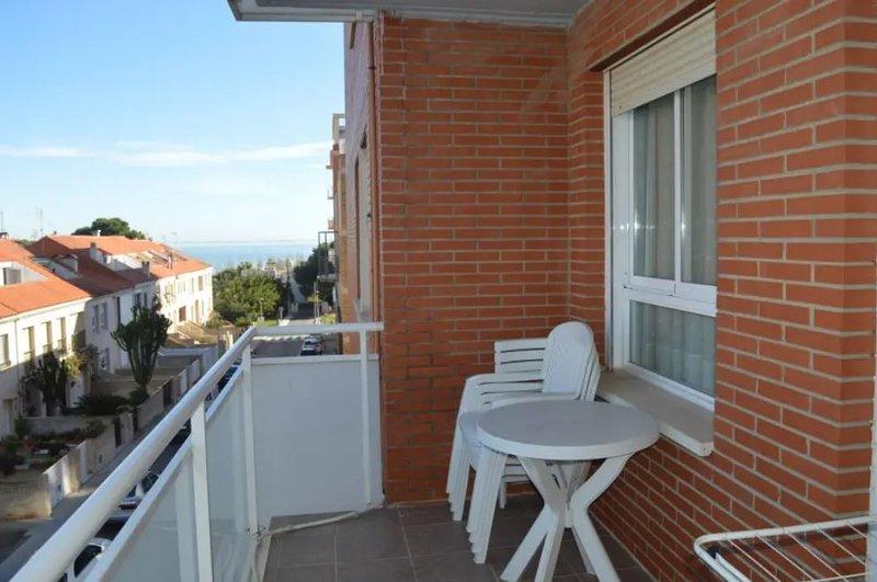 Apartment with shared pool, alquiler de vacaciones en Sant Carles de la Ràpita