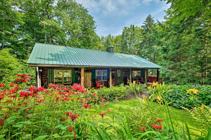 The 4-bedroom, 2-bathroom vacation rental cabin sleeps 8 guests.