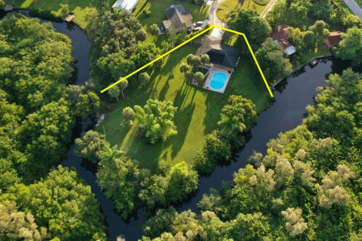 Located on 3/4 acres, bordered by a canal that takes you to the river and a brand new dock, this property is a piece of Old Florida paradise.