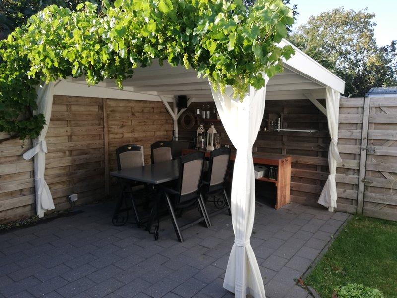 Terraza cubierta y protegida