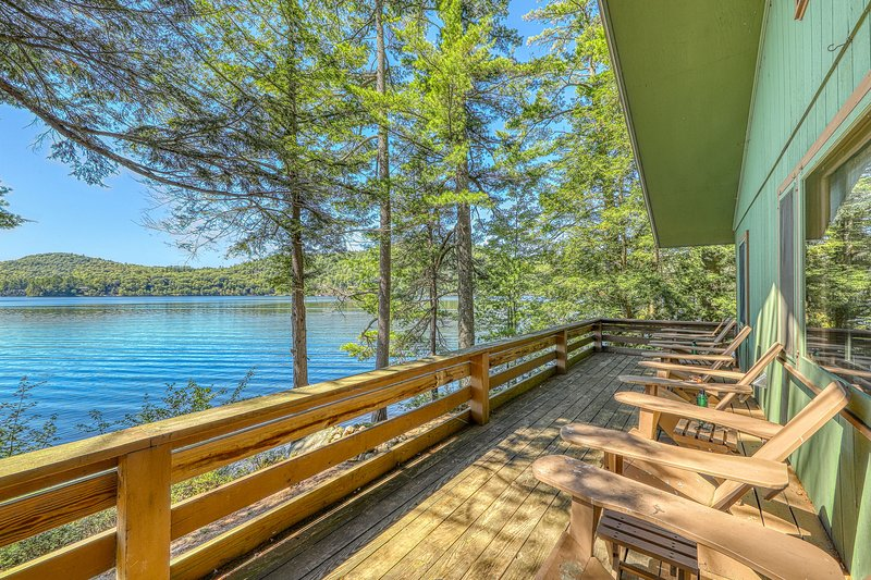 New listing! Dog-friendly, lakefront house w/sandy beach, dock, private location, holiday rental in Brant Lake