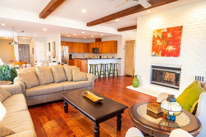 Living room with ample sitting for family gatherings and double-sided fireplace
