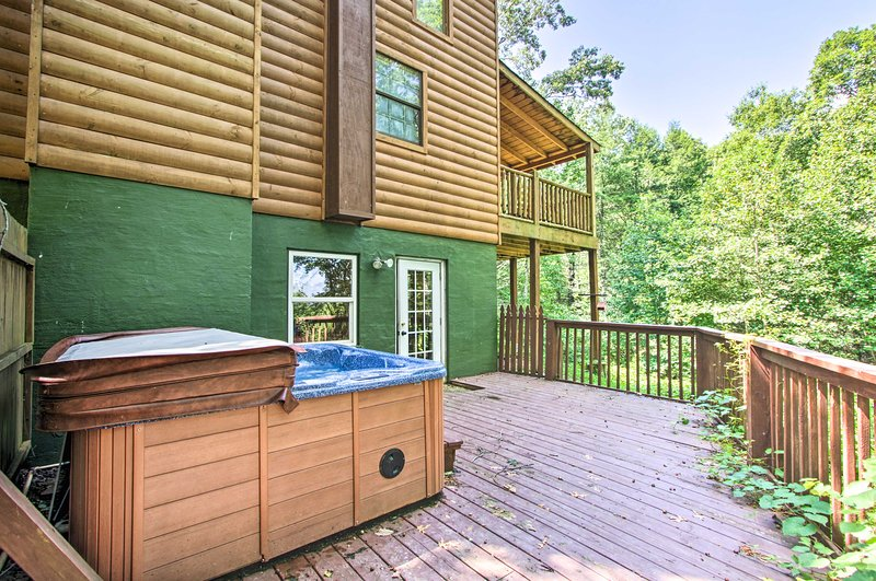 This vacation rental cabin boasts a hot tub.