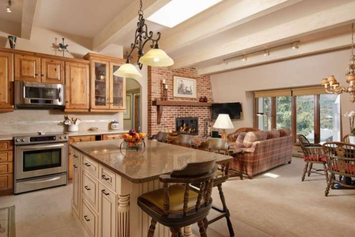 The newly remodeled kitchen flows into the warm and inviting dining and living areas of this comfortable vacation rental.