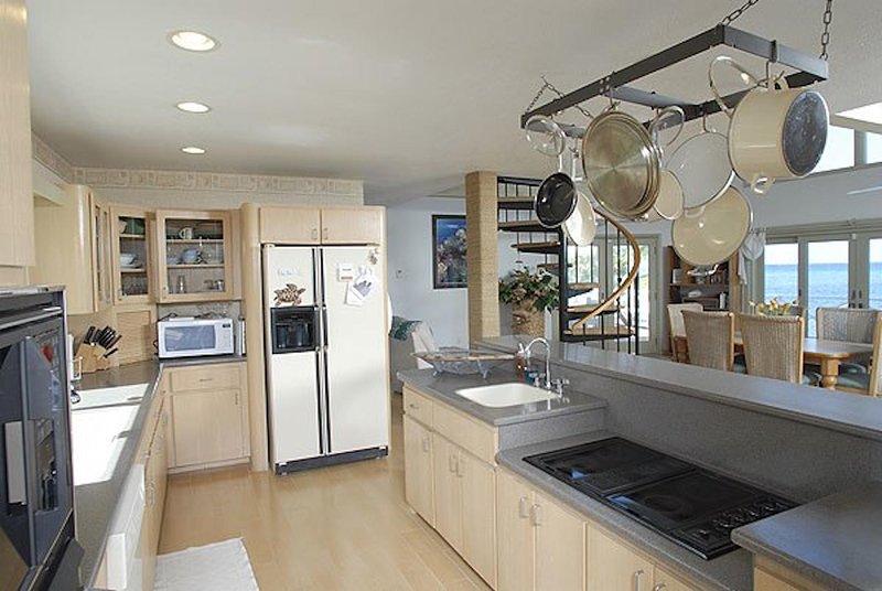 Galley kitchen with modern appliances.