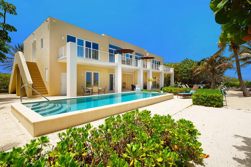 Welcome to Villa Caymanas featuring stunning architectural details and a oceanfront private pool.