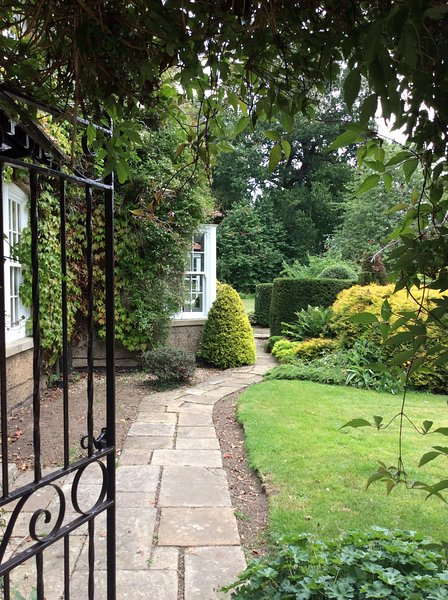 Private guest entrance through the beautiful gardens.