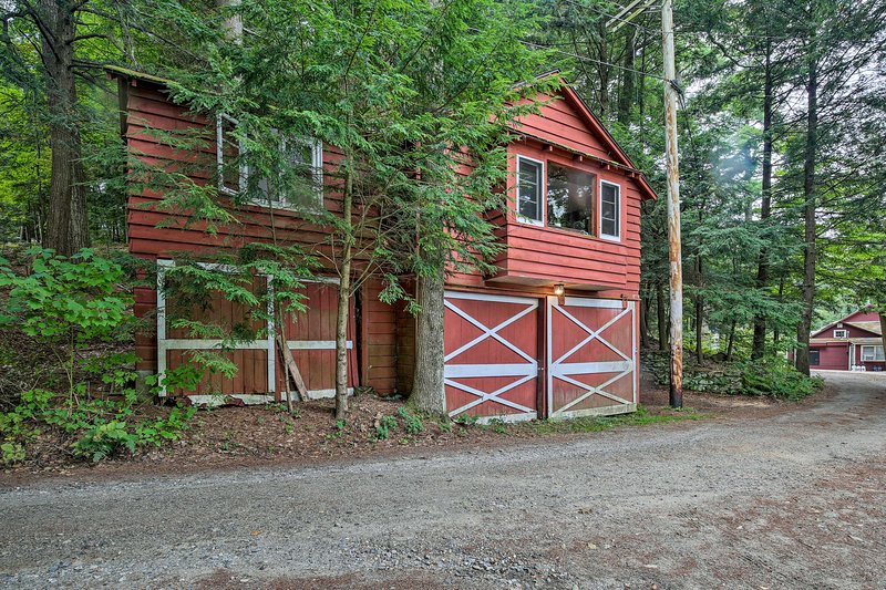 The home's red wood exterior adds to its natural charm.