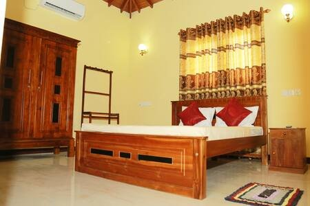 large, spacious, A double bed with  comfortable mattress, A/C, ceiling fan, beautiful wood ceiling