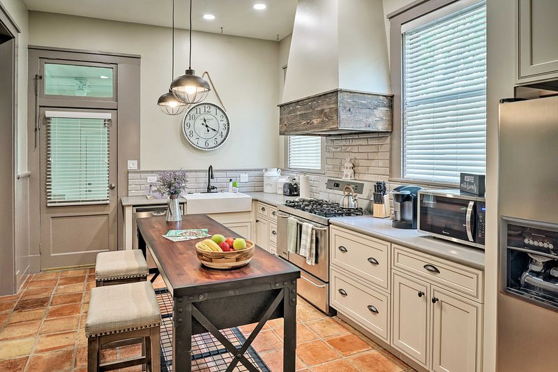 This San Antonio home-away-from-home offers a stunning fully equipped kitchen.
