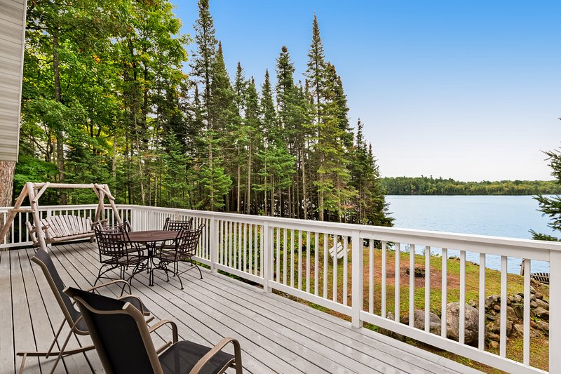 Beautiful home on High Lake w/private pier, large deck & canoes, holiday rental in Boulder Junction