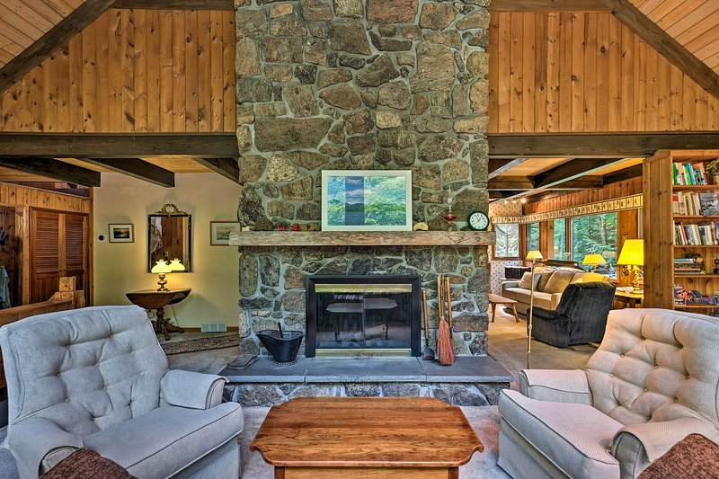 Unwind by the elegant fireplace after a day on the lake.