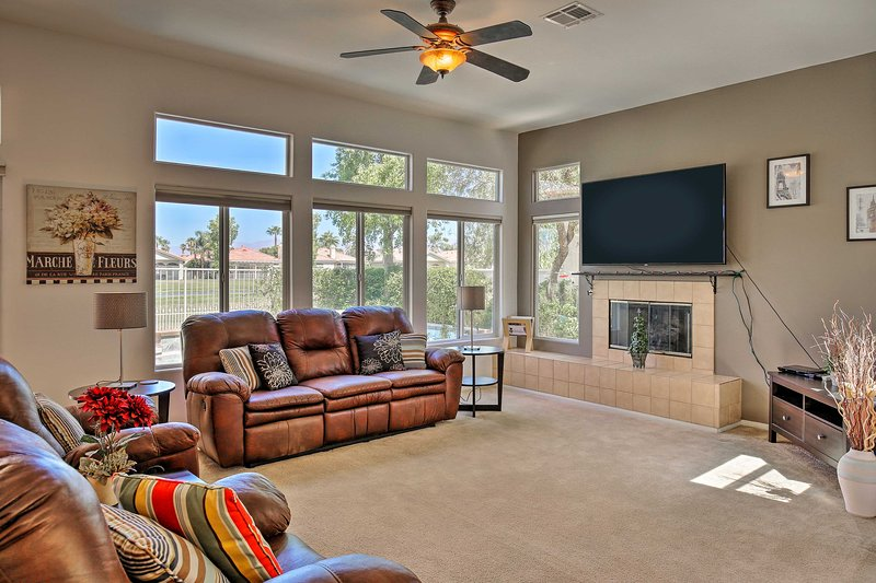 Sit back and relax in the living room after a day on the golf course.