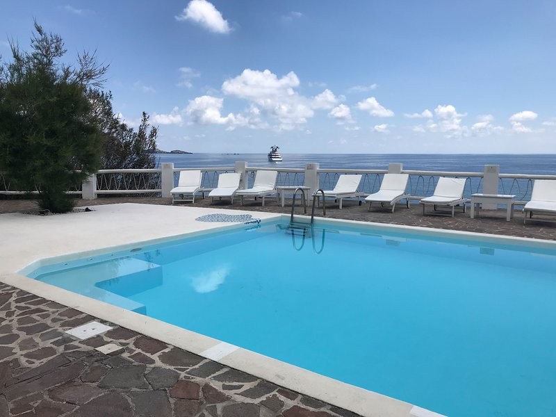 Seaside Italian villa w/  ocean views, private patio, & gardens - shared pool!, holiday rental in Ginostra