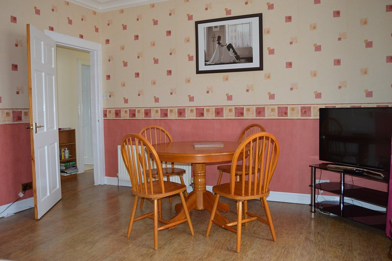 The dining section of the Living Room with one of several prints by Kirkcaldy artist Jack Vetrianno.