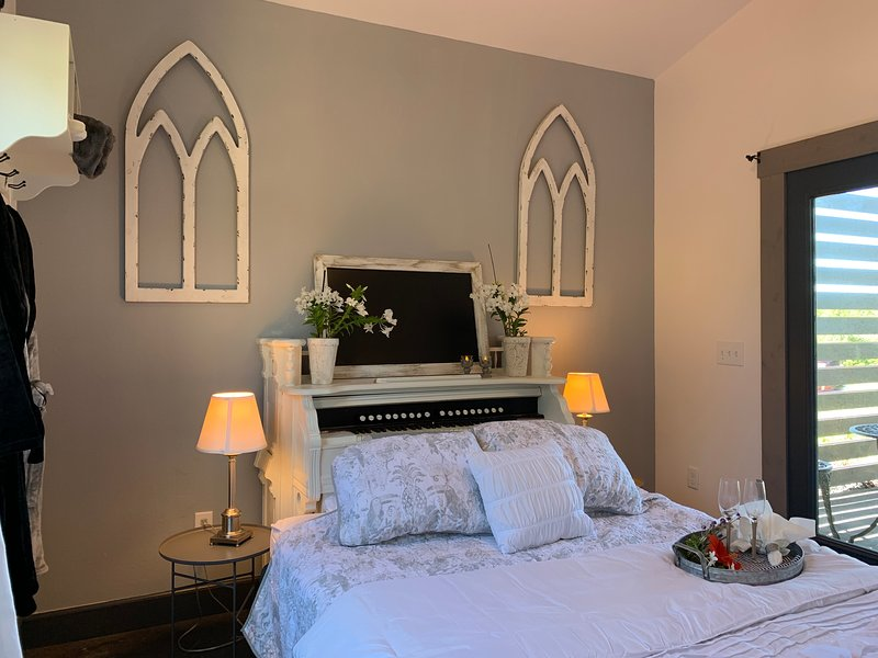 The Sanctuary Suite w new queen bed that boasts an antique organ as headboard!