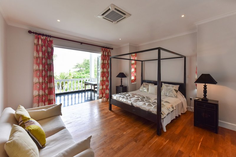 Criollo House: Ocean View Room 1, vacation rental in Beau Vallon