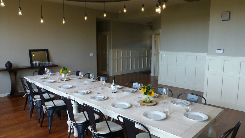 Entryway is freshly wainscoted, extra large farmhouse style dining table fits 14 to 16.