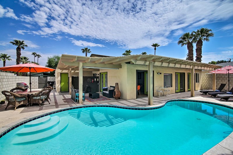 Enjoy the shade beneath the palm trees at this beautiful vacation rental!
