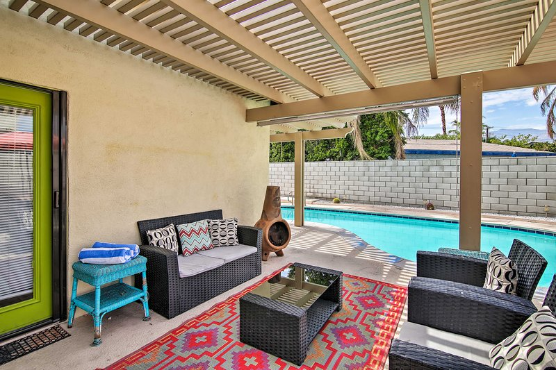 This 3-bed, 2-bath Palm Springs home offers a spacious patio with ample seating.
