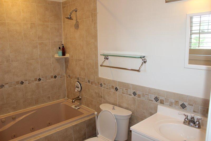 One of three Baths:  2 Full Bathrooms and one half bathroom