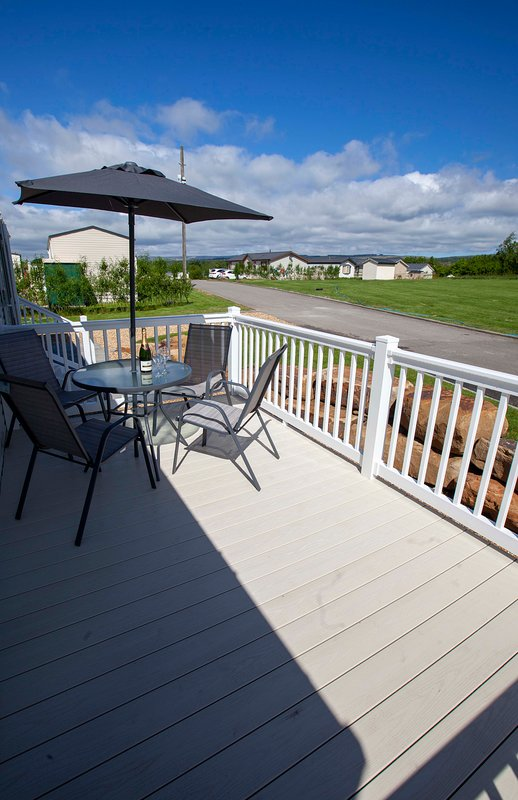 Sit and enjoy a glass of wine on the decking.