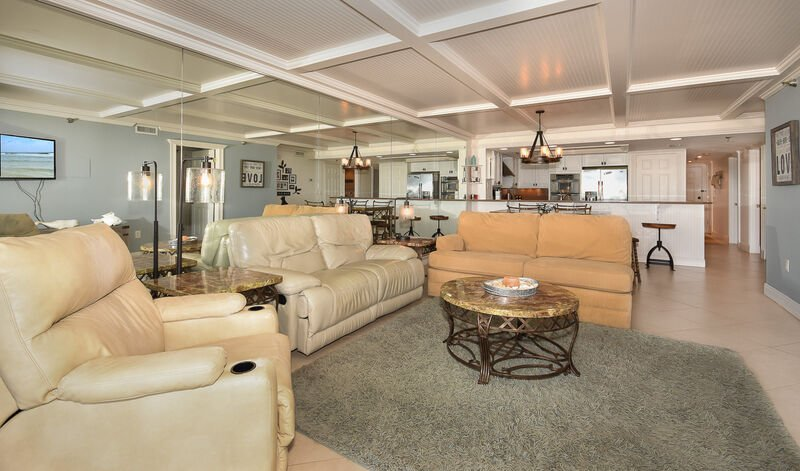 Beautifully decorated, oceanfront living room with flat screen TV, DVD, VCR and recliner.