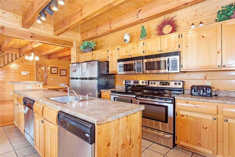 Kitchen with double stainless steel appliances