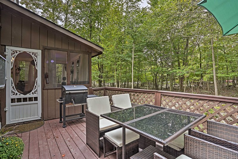 This 3-bed, 1.5-bath home offers a furnished deck with a charcoal grill!