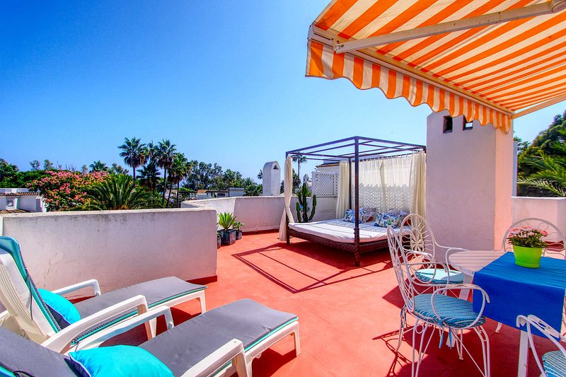 amazing roof terrace with day bed sunloungers and out door dining area