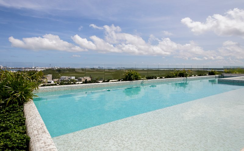 Take the Cancun sun while relaxing by the pool.