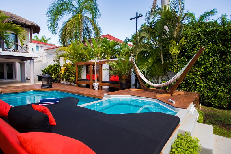 Backyard - you can see the pool, jacuzzi, 2 cabana day beds and hammock