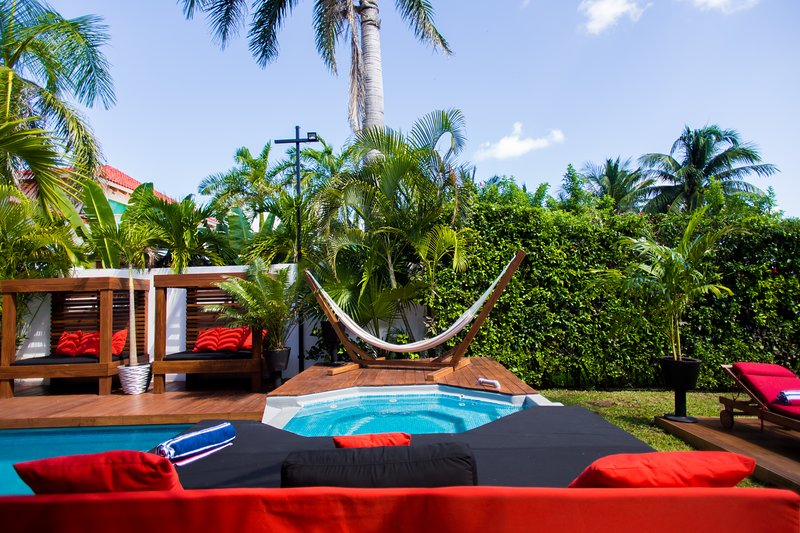 Relax by the pool on the Hammock or one of the day beds.