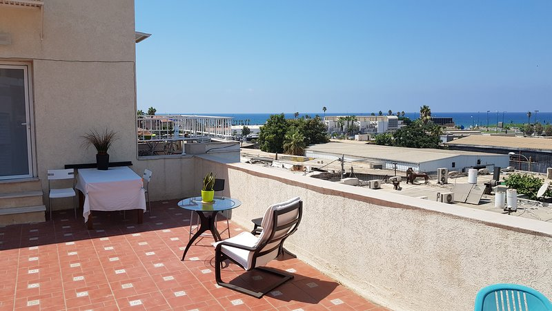 The top roof apartment is located in the charming  American / German colony and adjacent to beach.