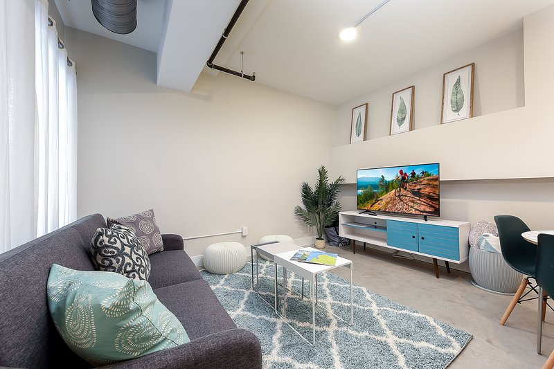 This contemporary space is brand new, well stocked and close to everything!