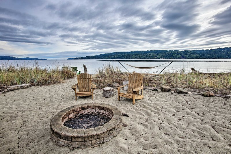 The 1-bathroom studio boasts shared access to the fire pit, beach, and hammock.