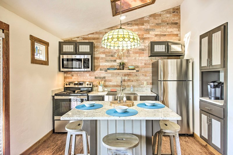 The modern kitchen boasts a 3-person island.
